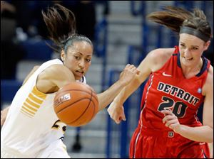 University of Toledo guard Inma Zanoguera (23) steals the ball from Detroit forward Megan Hatter (20).