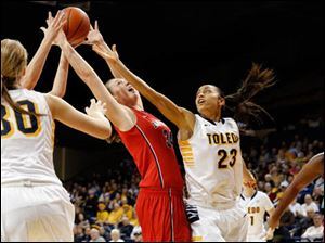 University of Toledo guard Inma Zanoguera (23) battles Detroit forward Megan Galloway (34).