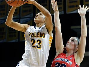 University of Toledo guard Inma Zanoguera (23) goes to the net against Detroit forward Megan Hatter (20).