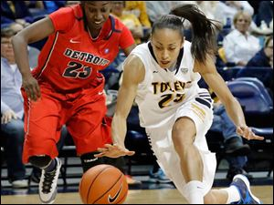 University of Toledo guard Inma Zanoguera (23) steals the ball from Detroit guard Senee Shearer (23).