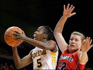 University of Toledo guard Janelle Reed-Lewis (5) goes to the net against Detroit guard Ellisha Crosby (32).