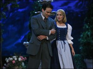 "Stephen Moyer, left, as Captain Von Trapp and Carrie Underwood as Maria, in ""The Sound of Music Liv"