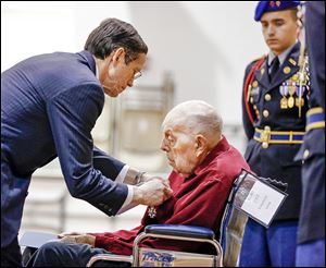 French Consul Stephen Knerly, Jr., awards John Stauffer, 91, the Medal of Knight of the Legion of Honor — France's highest award — at the Ohio Veterans Home. Mr. Stauffer was wounded at Normandy in World War II.
