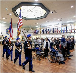 Members of Lorain High School's Junior ROTC present the colors during a French Legion of Honor ceremony in which six U.S. veterans from Ohio who helped liberate France during World War II were honored.