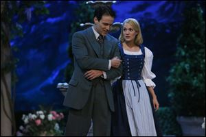 Stephen Moyer, left, as Captain Von Trapp and Carrie Underwood as Maria, in