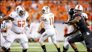BG quarterback Matt Johnson completed 21 of 27 passes for 397 yards against Northern Illinois on Friday night.