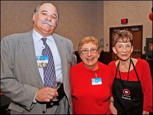 President and CEO of St. Luke's Hospital Dan Wakeman, left, and event co-chairmen Pat Polca, center, and Sheila Wineman-Krieger, right, at the ProMedica St. Luke's Auxiliary's Three Blind Wines Tasting.