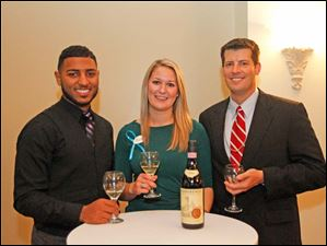 Ian Iler, left, Emily Lyczkowski, center, and Ryan Beat, right, at the Kidney Foundation wine event.