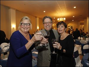 Cynthia Sippel, left, Randy Lake, center, and Janna Lake, right, enjoy the Kidney Foundation of Northwest Ohio's wine event at the Parkway Place.