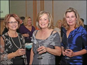 Anna Kidston of Pioneer, left, Kathy Davis of St. Henry, and Deborah Koules of Chicago, right, attended this year's Mobile Meals Wine Gala.