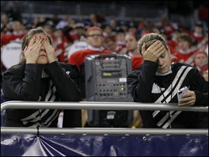 Members of the Northern Illinois University band can't watch as the Huskies fall further behind.