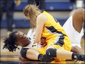 University of Toledo basketball player Brianna Jones (50) fights for the ball with Valparaiso University player Jessi Wiedemann (44) during the second half.