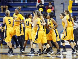 Valparaiso University players celebrate their win over the University of Toledo.
