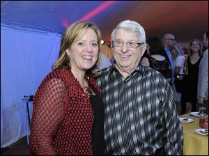Sue Jablonski, left, with her dad, Tony Falzone. Funds raised at this year's event will go in part to build a new Mary Ellen Falzone Diabetes Center, set to open in early 2014. Mr. Falzone and his wife, Mary Lour, were honorary chairmen of the ProMedica Wine Event.