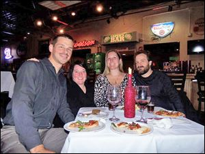 From left, Jason and Jaimie Foster, and Heather and Douglas Mallette wine and dine together at the fund-raiser for Toledo Unleashed.