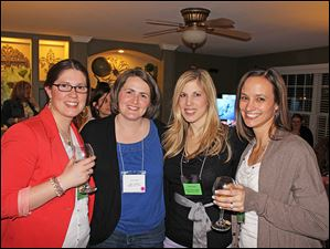 Members of the Mothers' Center enjoy wine and friendships. From left are Kristina White, Tricia Carrero, Krysta Lawver, and Joelle Olzak.