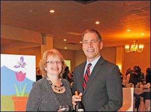 Dr. Diane M. Cappelletty, left, and Dr. Steve Martin, right, enjoy the Kidney Foundation wine event at the Parkway Place.