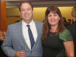 Dr. Chris Riordan, left, and his wife Kelly of Maumee at the gala.