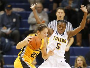 University of Toledo basketball player Janelle Reed-Lewis (5) defends against Valparaiso University player Lexi Miller (21) during the first half.