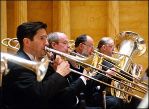 From left: Toledo Symphony brass players Garth Simmons, trombone; Charles Slater, trombone; Daniel Harris, bass trombone, and David Saltzman, tuba, perform at Carnegie Hall in 2011.