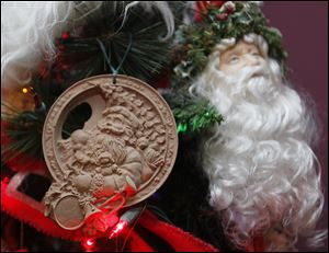 Two Santa Claus ornaments on Mrs. Christenson's always-up tree. The one on the left is made from crushed pecan shells.
