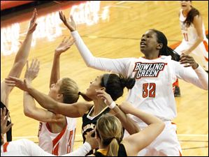 BG's Alexis Rogers reaches for a rebound.
