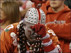 An Ohio State fan reacts near the end of the Big Ten Conference championship.