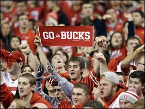 An Ohio State fan cheers before the start of the game.
