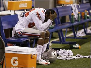 Ohio State's Corey Smith reacts on the bench near the end of the game.