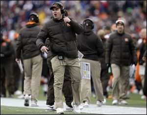 Cleveland Browns head coach Rob Chudzinski shouts instructions in the second quarter of an NFL football game against the New England Patriots on, Sunday in Foxborough, Mass.