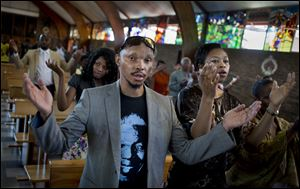 Mourners attend an early morning church service in memory of Nelson Mandela at the Regina Mundi church, which became one of the focal points of the anti-apartheid struggle, in Soweto, Johannesburg,
