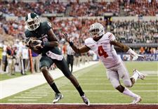 Michigan-State-s-Tony-Lippett-left-makes-a-33