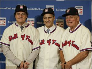 Retired managers, from left, Tony La Russa, Joe Torre and Bobby Cox gather for a photo after it was announced that they were unanimously elected to the baseball Hall of Fame during MLB winter meetings in Lake Buena Vista, Fla., today.