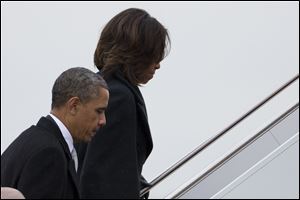 President Obama and first lady Michelle Obama board Air Force One to travel to South Africa for a memorial service in honor of Nelson Mandela today in Andrews Air Force Base, Md. (AP Photo/ Evan Vucci)