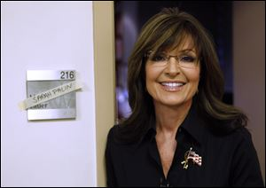 "The Sportsman Channel said Monday it has hired Sarah Palin to be host of a weekly outdoors-oriented program that will celebrate the ""red, wild and blue"" lifestyle."