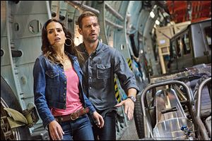 Jordana Brewster, as Mia, and the late Paul Walker, as Brian, make a break for it in 'Fast & Furious 6,' the latest installment of the global blockbuster franchise built on speed.