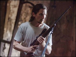 "Christian Bale in a scene from ""Out of the Furnace."""