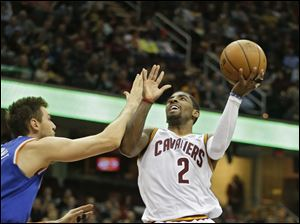 Cleveland Cavaliers' Kyrie Irving (2) shoots against New York Knicks' Andrea Bargnani.