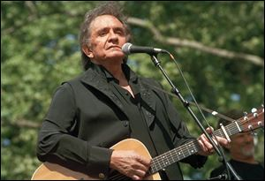 Johnny Cash performs at a benefit concert in Central Park in New York in May, 1993.