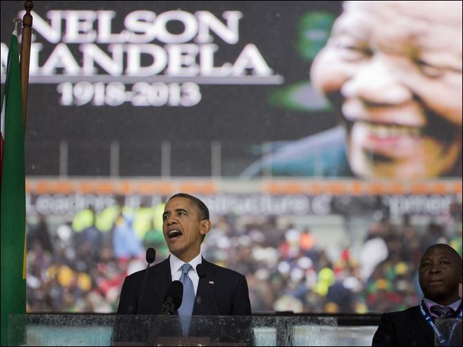 South Africa Mandela Memorial President Obama speaks to crowds attending the memorial service for former South African president Nelson Mandela at the FNB Stadium in Soweto.