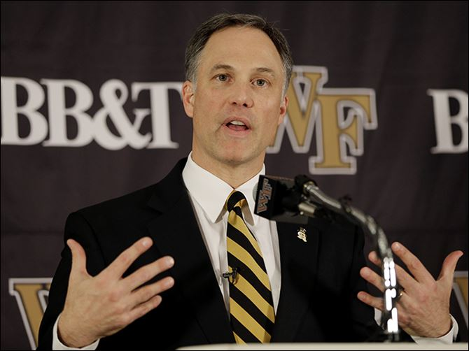 s4dave-2 Dave Clawson is introduced as the new football coach for Wake Forest. In five seasons, he led the Falcons to a 32-31 record and clinched the program's first league title since 1992.