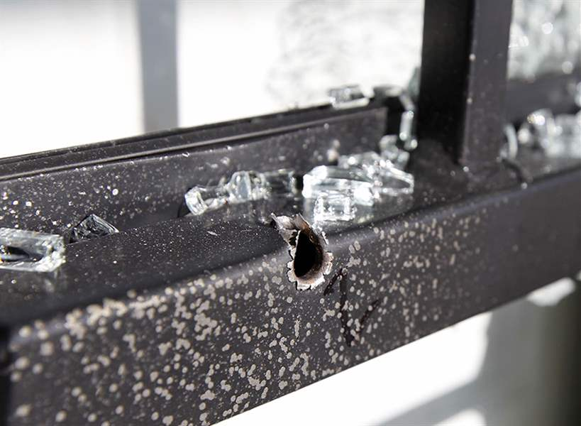A-bullet-hole-in-the-screen-door-pa
