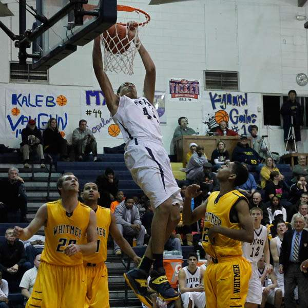 St-Johns-Myles-Copeland-dunks-over-Whitmer-defense