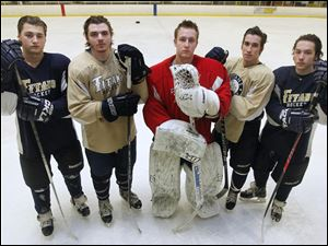 St. John's hockey players from left: Ian Rapp,  Dominic Horvath, Mike Barrett, Ben Hamilton and Caleb Hauenstein.'s