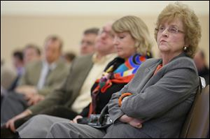 Bowling Green State University President Mary Ellen Mazey listens during a presentation  of findings of an audit of BGSU operations.