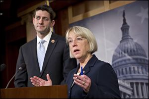 House Budget Committee Chairman Paul Ryan, R-Wis., left, and Senate Budget Committee Chairwoman Patty Murray, D-Wash., announce a tentative agreement between Republican and Democratic negotiators on a government spending plan, at the Capitol in Washington, Tuesday.