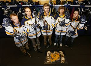 Whitmer High School hockey players  Devin Herzig, Aaron Thoman, Hunter Carr, Cody Calendine.