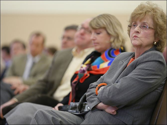 n5bgsu-1 Bowling Green State University President Mary Ellen Mazey listens during a presentation  of findings of an audit of BGSU operations.