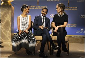 From left, Zoe Saldana, Aziz Ansari and Olivia Wilde chat onstatge before the nominations for the 71st Annual Golden Globe Awards today in Beverly Hills, Calif.