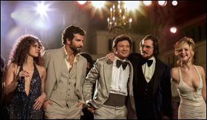 From left,  Amy Adams, Bradley Cooper, Jeremy Renner, Christian Bale and Jennifer Lawrence in a scene from